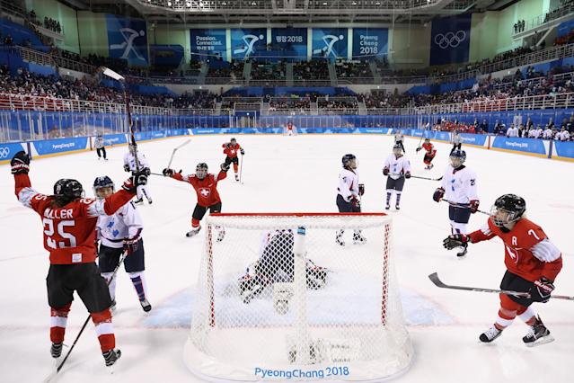 <p>Alina Muller #25 of Switzerland celebrates after scoring a goal against So Jung Shin #31 of Korea in the first period during the Women's Ice Hockey Preliminary Round – Group B game on day one of the PyeongChang 2018 Winter Olympic Games at Kwandong Hockey Centre on February 10, 2018 in Gangneung, South Korea. (Photo by Bruce Bennett/Getty Images) </p>