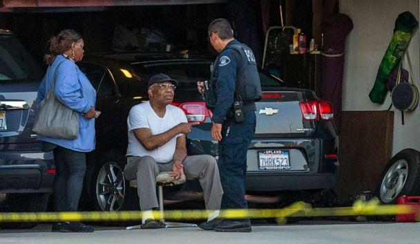 PHOTO:An Ontario Police officer interviews a neighbor sitting in his garage next door to a home where two children, an infant and a teenager, were found dead with their mother, who was unresponsive, Aug. 20, 2019, in Ontario, Calif. (Terry Pierson/The Orange County Register via AP)
