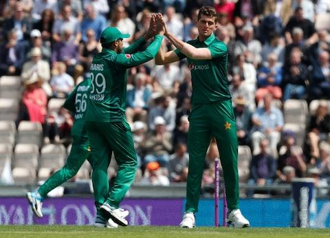 Pakistan's Shaheen Shah Afridi, right, celebrates with Pakistan's Haris Sohail, left, after taking the wicket of England's Jonny Bairstow - Credit: AP Photo/Frank Augstein