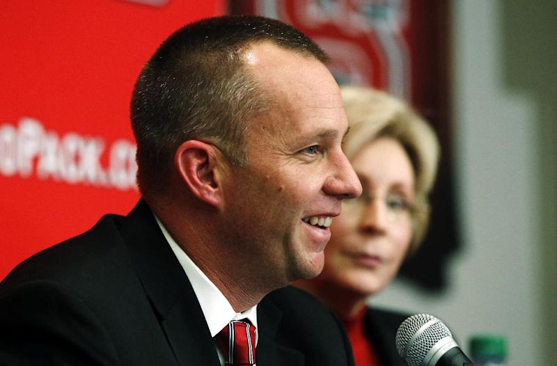 New North Carolina State head coach Dave Doeren, left, speaks alongside athletic director Debbie Yow during an NCAA college football news conference, Sunday, Dec. 2, 2012, in Raleigh, N.C. The news conference capped a busy 48-hour period that saw Doeren lead Northern Illinois to a second straight Mid-American Conference championship on Friday night, then agree to take over North Carolina State on Saturday and replace Tom O'Brien. (AP Photo/The News & Observer, Ethan Hyman) MANDATORY CREDIT