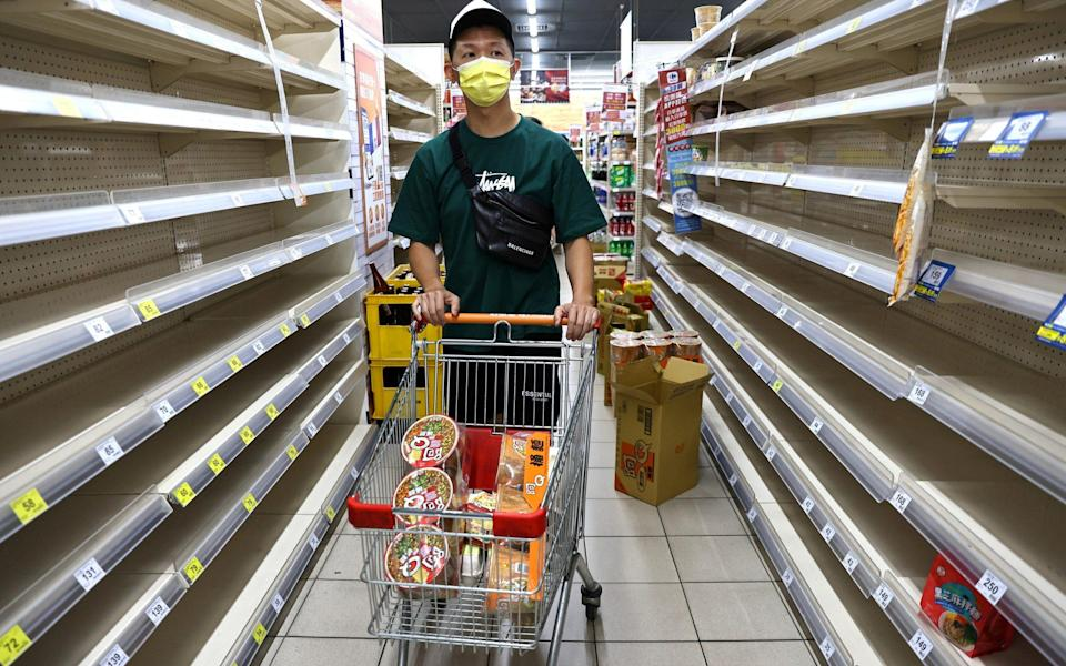 A customer attempts to grocery shop in Taipei - REUTERS/Ann Wang