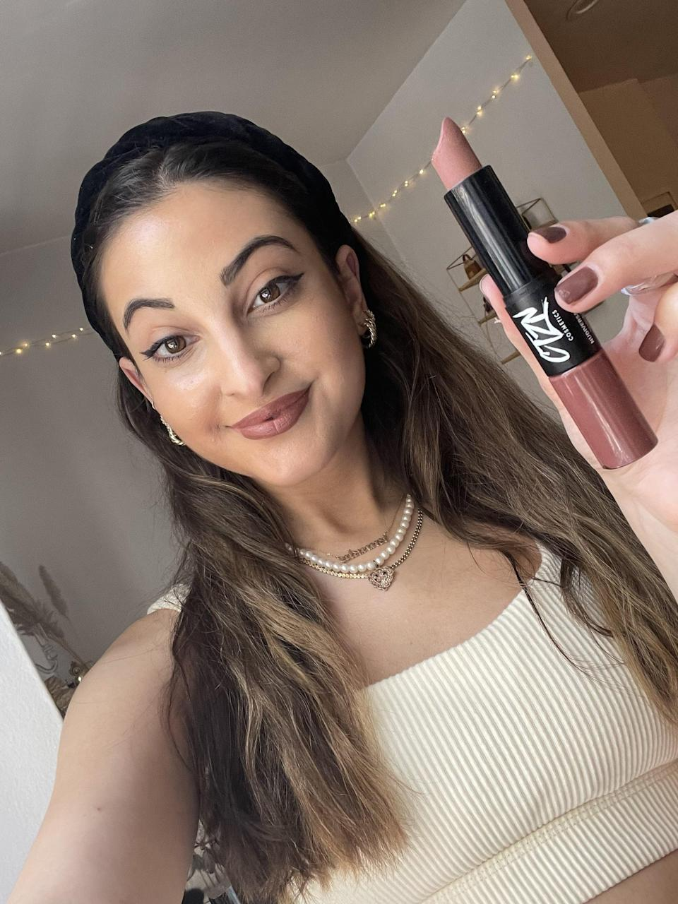 """<p>""""My ride-or-die lip color for fall for the past couple of years has been the <span>Nudiversal Lip Duo in Mykonos</span> ($25), a creamy, nude brown combo from Ctzn. The matte end is super pigmented and leaves behind a powdery (but non-cakey!) finish that instantly makes my makeup feel cozy and complete. To level up my lip look at night, I like to layer the gloss on top for extra sparkle and shine. It's the best $25 you'll spend this fall, I can promise you that."""" - Alanna Martine Kilkeary, assistant managing editor, Makeup.com</p>"""
