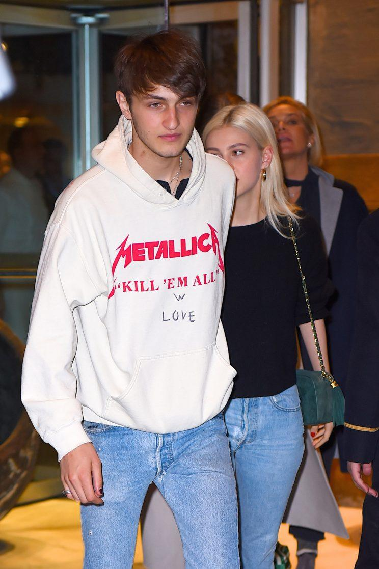Anwar Hadid, with girlfriend Nicola Peltz, added some love to his sweatshirt. (Photo: Getty Images)
