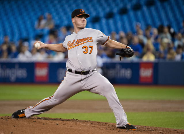 Baltimore Orioles starting pitcher Dylan Bundy (37) works against the Toronto Blue Jays during the first inning of a baseball game, Tuesday, Aug. 21, 2018, in Toronto. (Nathan Denette/The Canadian Press via AP)