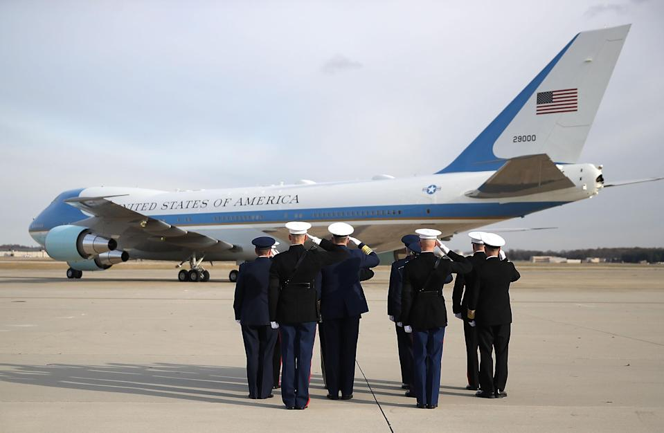 Members of the Joint Chiefs salute as a U.S. Air Force 747, that is being called 'Special Mission 41', takes off carrying the casket of former President George H.W. Bush, on Dec. 5, 2018 in Joint Base Andrews, Md. (Photo: Mark Wilson/Getty Images)