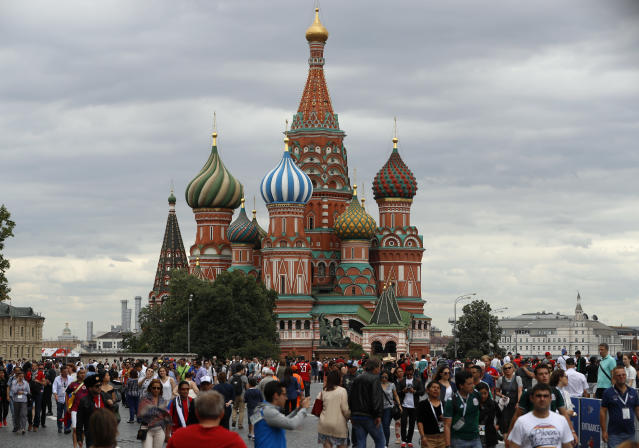 Soccer fans and tourists gather near Saint Basil's Cathedral on the Red Square during the 2018 soccer World Cup in Moscow, Russia, Thursday, June 21, 2018. (AP Photo/Darko Bandic)