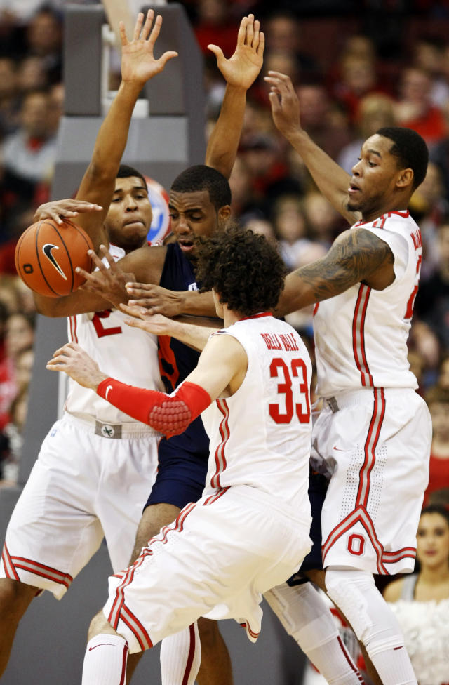 Morgan State's Justin Black (50) works for the ball against Ohio State's Marc Loving (2), Amedeo Della Valle (33) and Amir Williams (23) during the first half of an NCAA college basketball game in Columbus, Ohio, Saturday, Nov. 9, 2013. (AP Photo/Paul Vernon)