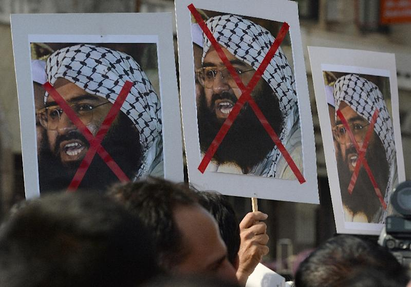 Indian activists carry placards of the chief of Jaish-e-Mohammad, Maulana Masood Azhar during a protest against the attack on the air force base in Pathankot, in Mumbai on January 4, 2016 (AFP Photo/Indranil Mukherjee)