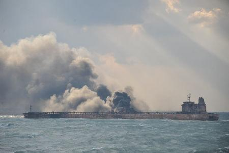 Smoke is seen from the Panama-registered Sanchi tanker carrying Iranian oil, which went ablaze after a collision with a Chinese freight ship in the East China Sea, in this January 9, 2018 handout picture released by China's Ministry of Transport January 10, 2018. China's Ministry of Transport/Handout via REUTERS