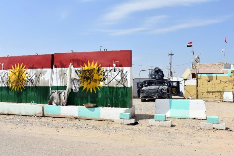 "An Iraqi general said federal troops retook ""Base 102"" west of Kirkuk after peshmerga forces withdrew during the night without a fight"