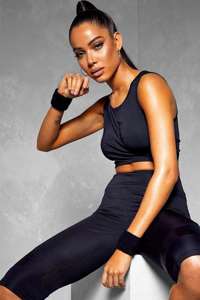 "<p>This cute <a href=""https://www.popsugar.com/buy/Boohoo-Fit-Wrap-Over-Sports-Bra-548940?p_name=Boohoo%20Fit%20Wrap%20Over%20Sports%20Bra&retailer=us.boohoo.com&pid=548940&price=6&evar1=fit%3Aus&evar9=47217672&evar98=https%3A%2F%2Fwww.popsugar.com%2Ffitness%2Fphoto-gallery%2F47217672%2Fimage%2F47217673%2FBoohoo-Fit-Wrap-Over-Sports-Bra&list1=shopping%2Cworkout%20clothes%2Cproducts%20under%20%2450%2Cboohoo%2Cfitness%20shopping%2Caffordable%20shopping&prop13=mobile&pdata=1"" rel=""nofollow"" data-shoppable-link=""1"" target=""_blank"" class=""ga-track"" data-ga-category=""Related"" data-ga-label=""https://us.boohoo.com/fit-wrap-over-sports-bra/FZZ74702.html"" data-ga-action=""In-Line Links"">Boohoo Fit Wrap Over Sports Bra</a> ($6, originally $12) doubles as a crop top.</p>"