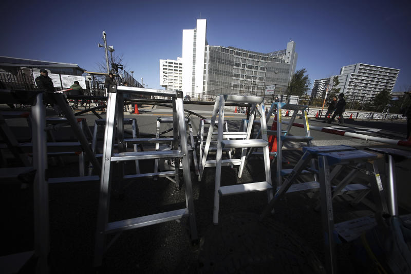 Step ladders placed by photographers and cameramen are seen in front of Tokyo Detention Center, where former Nissan chairman Carlos Ghosn is detained, in Tokyo Friday, Jan. 11, 2019. Ghosn has recovered from a fever, his lawyer Motonari Ohtsuru said Friday as the 64-year-old executive's latest detention period was set to expire.(AP Photo/Eugene Hoshiko)