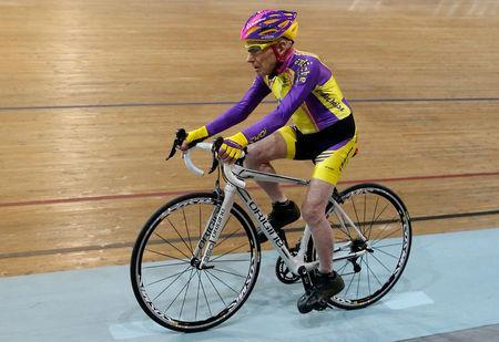FILE PHOTO: French cyclist Robert Marchand, aged 105, rides on his way to cover 22.528 km (14.08 miles) in one hour to set a new record at the indoor Velodrome National in Montigny-les-Bretonneux, southwest of Paris, France, January 4, 2017. REUTERS/Jacky Naegelen/File Photo