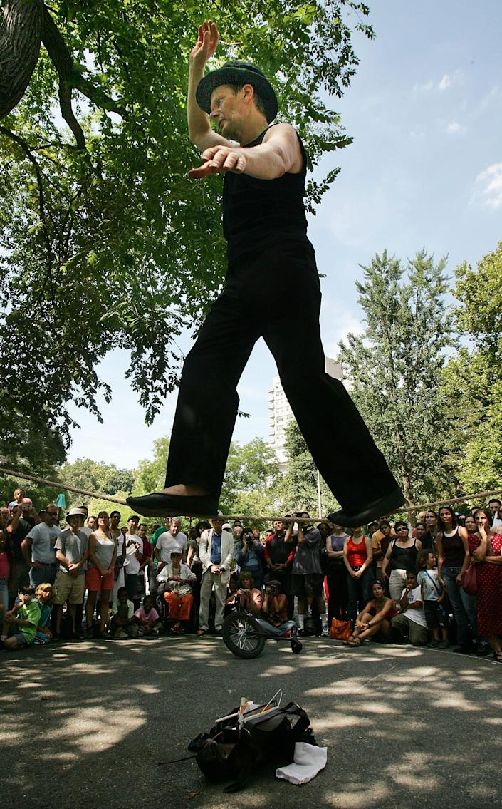 French aerialist Philippe Petit performs for a crowd in Washington Square Park August 6, 2005 in New York City. (Photo by Mario Tama/Getty Images)