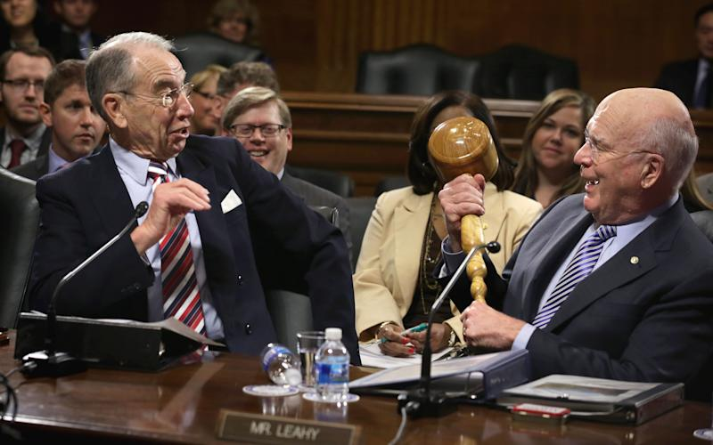 U.S. Sen. Chuck Grassley (R-Iowa), left, reacts as Sen. Patrick Leahy (D-Vt.) brings out a giant gavel while making remarks during an executive business meeting of the Senate Judiciary Committee on Jan. 22, 2015. Leahy ceremonially passed the gavel to Grassley who has taken up the chairmanship after the Republicans won the majority in the Senate.