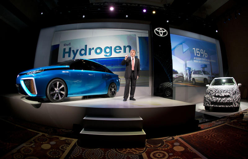 Toyota vice president and general manager Bob Carter talks about Toyota's FCV hydrogen electric concept car during the International Consumer Electronics Show, Monday, Jan. 6, 2014, in Las Vegas. Carter announced the car would be be available to consumers in 2015. (AP Photo/Julie Jacobson)