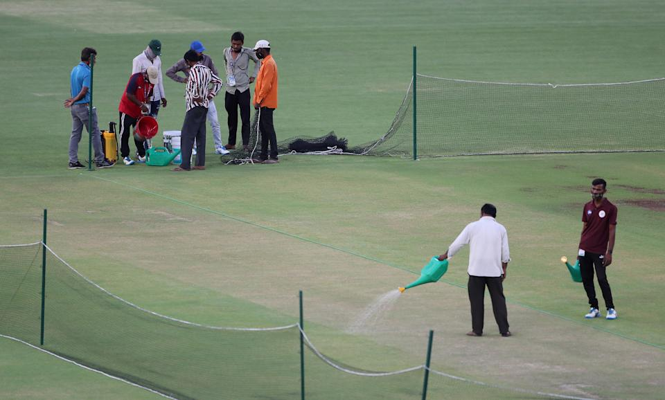 Groundstaff work on the pitch at the Narendra Modi Stadium in Ahmedabad. (Photo by Surjeet Yadav/Getty Images)