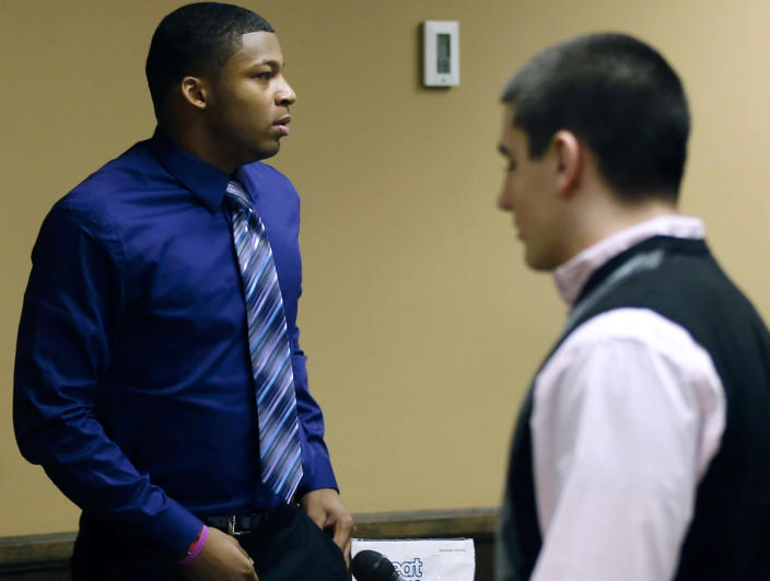 Ma'lik Richmond, 16, left, and co-defendant Trent Mays, 17, right, walks around in the court room during a break on the fourth day of their trial on rape charges in juvenile court on Saturday, March 16, 2013 in Steubenville, Ohio. The pair are accused of raping a 16-year-old West Virginia girl in August 2012. (AP Photo/Keith Srakocic, Pool)