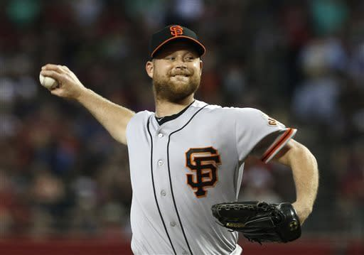 San Francisco Giants' Chad Gaudin throws against the Arizona Diamondbacks during the first inning in a baseball game on Sunday, June 9, 2013, in Phoenix. (AP Photo/Ross D. Franklin)