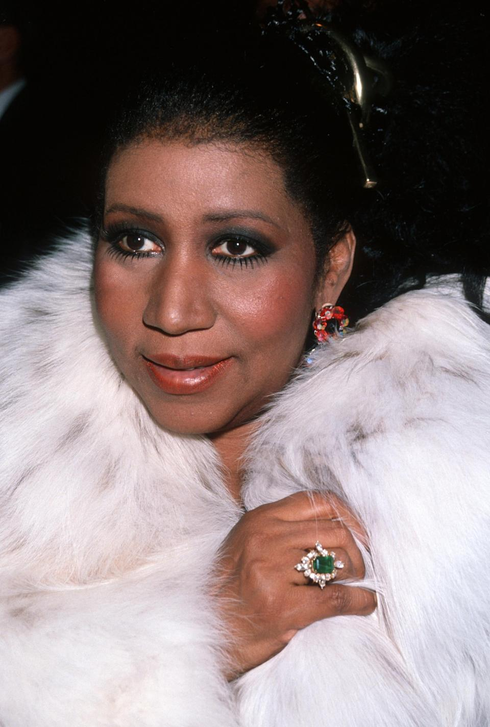 <p>Aretha Franklin wears a luxurious white fur coat, emerald and diamond ring, and smoky eyeshadow for the Night of 100 Stars. (Photo by Ron Galella, Ltd./WireImage) </p>