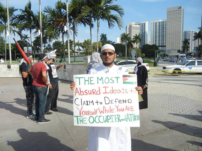 Salman Rashid, in a photo on Facebook, at a protest in Downtown Miami in 2014.
