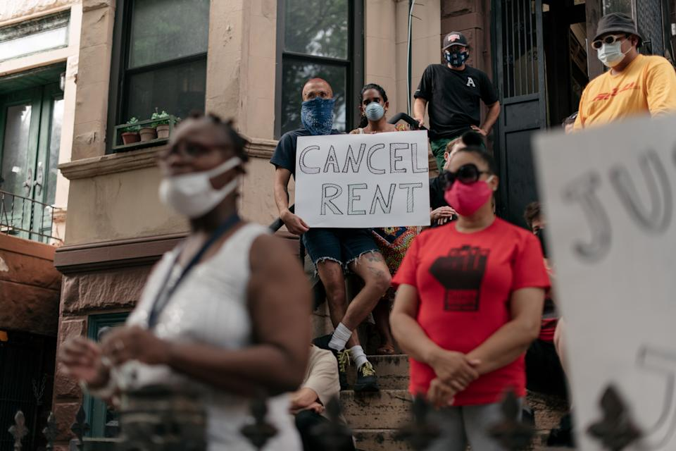 Housing activists gather to protest alleged tenant harassment by a landlord and call for the cancellation of rent in the Crown Heights neighborhood of Brooklyn on July 31. (Photo by Scott Heins/Getty Images)