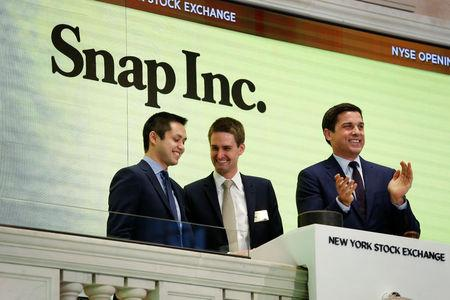 Snap cofounders Evan Spiegel (C) and Bobby Murphy ring the opening bell of the New York Stock Exchange with NYSE Group President Thomas Farley.  REUTERS/Lucas Jackson