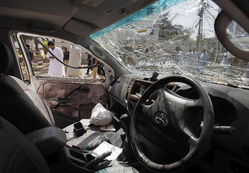 An inside view of a car damaged during a bomb blast in Karachi, Pakistan, Friday, April 25, 2014. A powerful bomb exploded Friday in an upscale residential area of southern Pakistan, killing several people and wounding others, authorities said. The attack took place in the neighborhood of Clifton in Karachi, the capital of southern Sindh province, senior police officer Abdul Khaliq Sheikh said. The bomb badly damaged several vehicles and a nearby multi-story building, he said. (AP Photo/Fareed Khan)