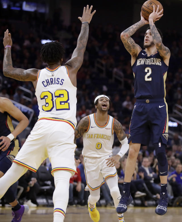 New Orleans Pelicans' Lonzo Ball, right, shoots as Golden State Warriors' D'Angelo Russell (0) and Marquese Chriss (32) defend during the first half of an NBA basketball game Friday, Dec. 20, 2019, in San Francisco. (AP Photo/Ben Margot)