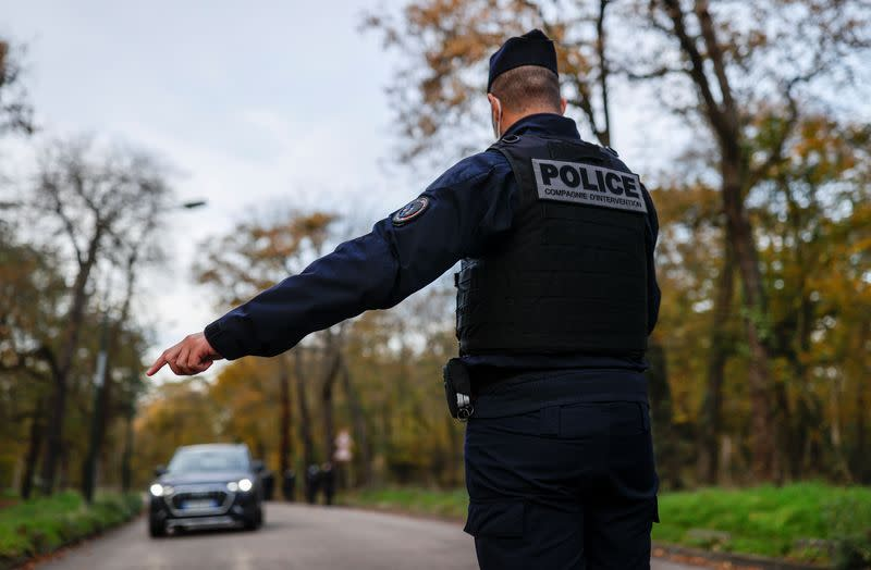 French police officers conduct control to check exemption certificates in Paris