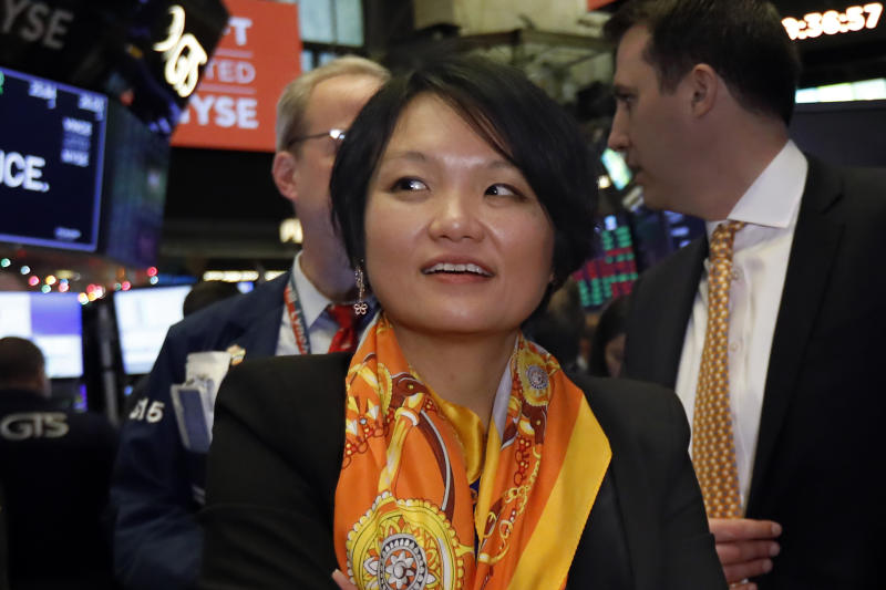 OneConnect Director Jessica Tan is photographed on the floor of the New York Stock Exchange, Friday, Dec. 13, 2019. (AP Photo/Richard Drew)
