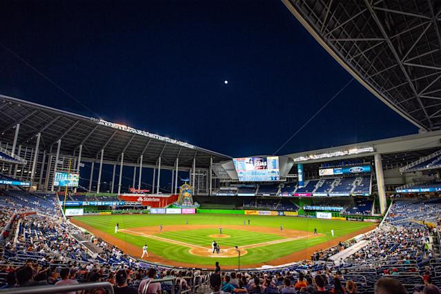 The Miami Marlins' average attendance is down from 20,585 to 10,054.