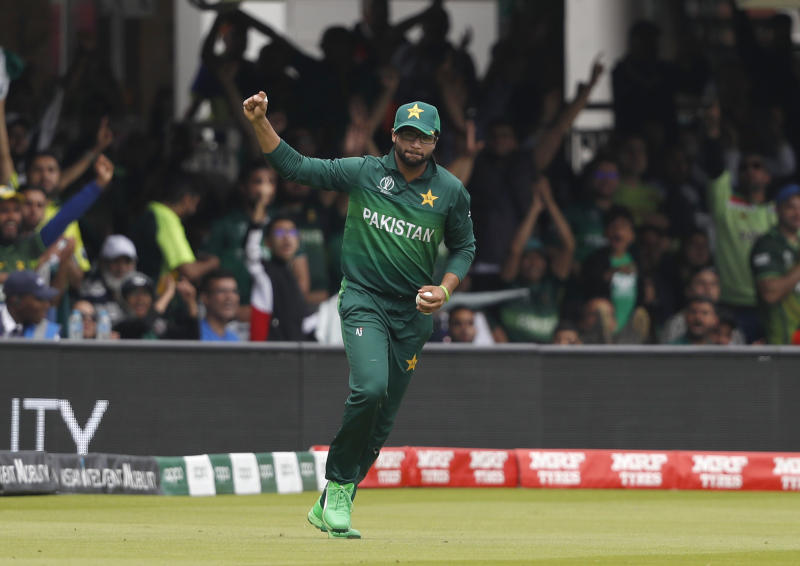 Pakistan's Imam-ul-Haq celebrates after taking a catch to dismiss South Africa's Quinton de Kock during their Cricket World Cup match between Pakistan and South Africa at Lord's cricket ground in London, Sunday, June 23, 2019. (AP Photo/Alastair Grant)