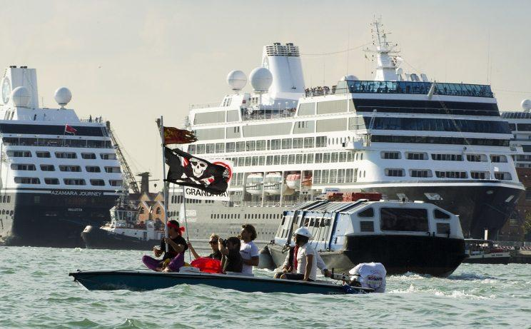Demonstrators dressed as pirates protest cruise ships in Venice