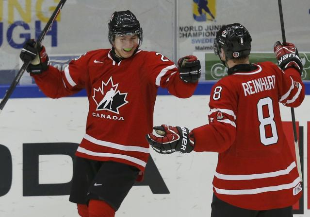 Canada's Curtis Lazar (L) celebrates his goal against Switzerland with teammate Griffin Reinhart during the third period of their IIHF World Junior Championship ice hockey game in Malmo, Sweden, January 2, 2014. REUTERS/Alexander Demianchuk (SWEDEN - Tags: SPORT ICE HOCKEY)