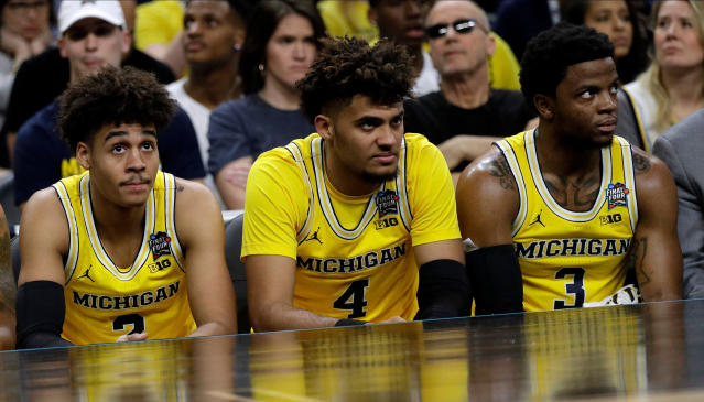 Michigan's Jordan Poole, from left, Isaiah Livers and Zavier Simpson watch from the bench during the second half against Loyola-Chicago in the semifinals of the Final Four NCAA college basketball tournament, Saturday, March 31, 2018, in San Antonio. (AP Photo/David J. Phillip)