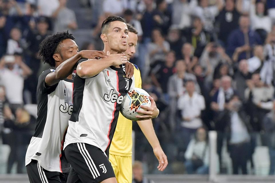 TURIN, ITALY - SEPTEMBER 21: Cristiano Ronaldo of Juventus celebrates after his goal of 2-1 with teammate Juan Cuadrado during the Serie A match between Juventus and Hellas Verona at Allianz Stadium on September 21, 2019 in Turin, Italy. (Photo by Daniele Badolato - Juventus FC/Juventus FC via Getty Images)