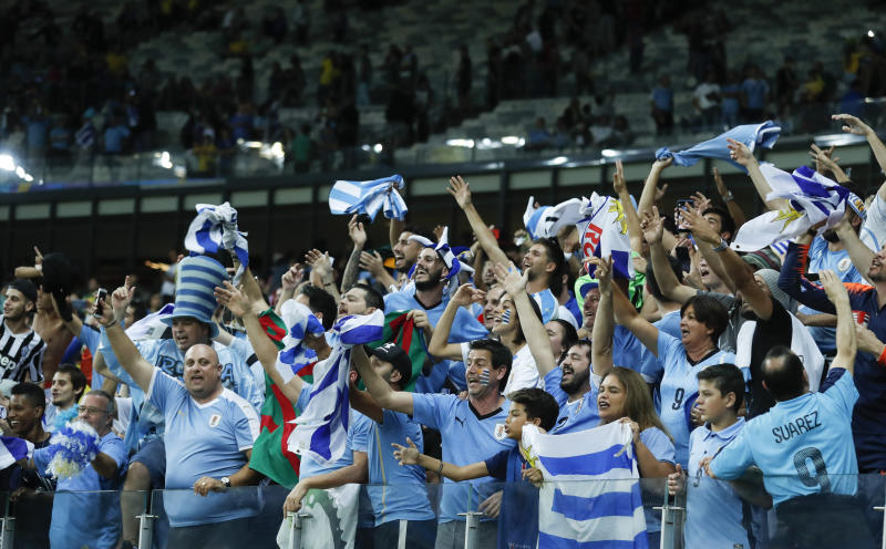 Uruguay fans celebrate after winning 4-0 a Copa America Group C soccer match against Ecuador at the Mineirao stadium in Belo Horizonte, Brazil, Sunday, June 16, 2019. (AP Photo/Victor R. Caivano)