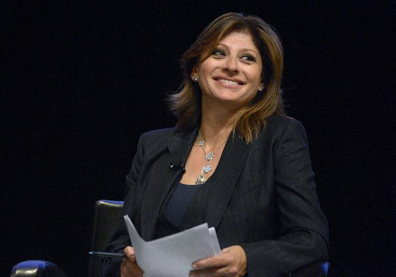 FILE - This Aug. 22, 2013 file photo shows CNBC television host Maria Bartiromo during a panel discussion at the Wal-Mart U.S. Manufacturing Summit in Orlando, Fla. Fox Business Network says veteran anchor and reporter Maria Bartiromo is joining up as its Global Markets Editor. Bartiromo will anchor a daily program for that network, plus a weekly business-oriented show for Fox News Channel. The network says she begins at Fox Business on Feb. 1, with both programs set to launch by April. (AP Photo/Phelan M. Ebenhack, File)