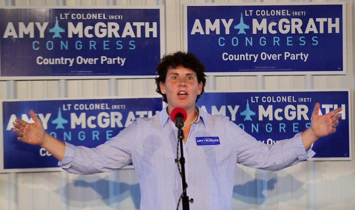 Congressional candidate Amy McGrath speaks at a potluck rally in Frankfort, Ky. Oct. 10, 2018