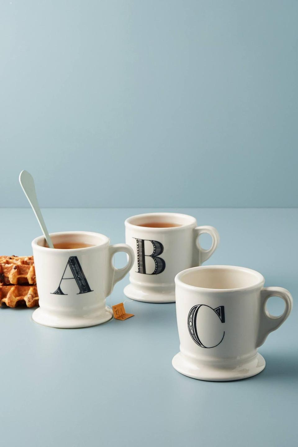 """<p><strong>Anthropologie</strong></p><p>anthropologie.com</p><p><strong>$10.00</strong></p><p><a href=""""https://go.redirectingat.com?id=74968X1596630&url=https%3A%2F%2Fwww.anthropologie.com%2Fshop%2Fmonogram-mug&sref=https%3A%2F%2Fwww.goodhousekeeping.com%2Fholidays%2Fgift-ideas%2Fg1432%2Fteacher-gifts%2F"""" rel=""""nofollow noopener"""" target=""""_blank"""" data-ylk=""""slk:Shop Now"""" class=""""link rapid-noclick-resp"""">Shop Now</a></p><p>Since there are probably plenty of apple-festooned mugs in the cupboard already, opt for this typewriter design instead, which offers a hint of a personal touch. </p>"""