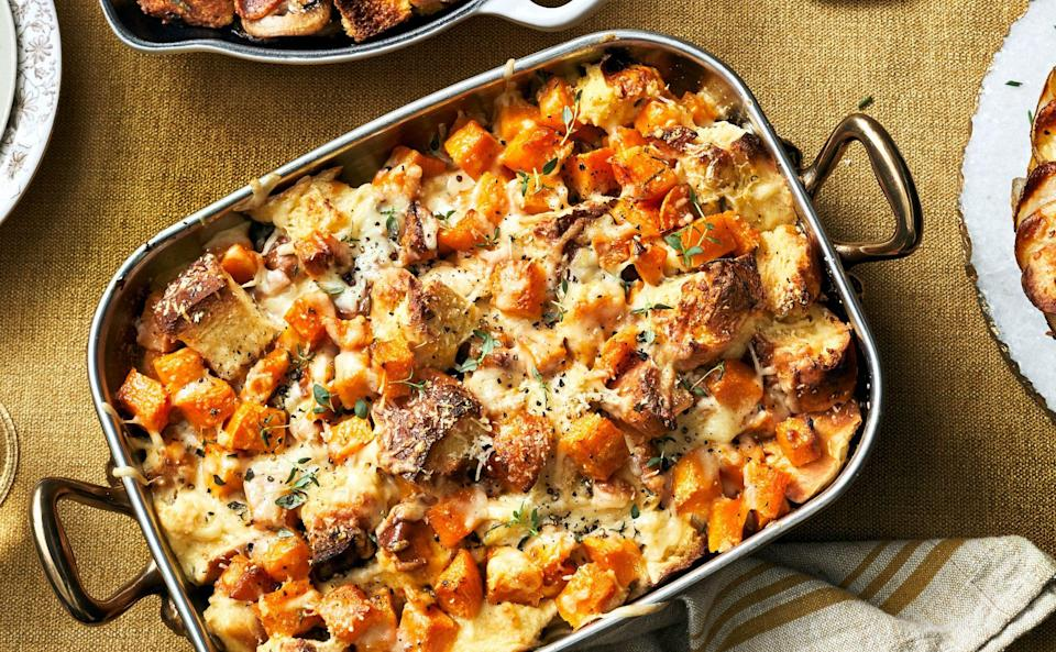 """<p><strong>Recipe: <a href=""""https://www.southernliving.com/recipes/butternut-squash-bread-pudding"""" rel=""""nofollow noopener"""" target=""""_blank"""" data-ylk=""""slk:Butternut Squash Bread Pudding"""" class=""""link rapid-noclick-resp"""">Butternut Squash Bread Pudding</a></strong></p> <p>When we say everyone will swoon over this side dish, we mean it. It's made with challah bread and flavored with Dijon mustard, rosemary, thyme, and both Gruyère and Parmesan cheeses. </p>"""