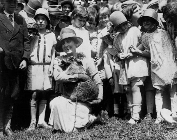 PHOTO: First Lady Grace Coolidge shows her pet raccoon to children gathered on the White House grounds for Easter egg rolling, circa 1923. (Library Of Congress via Getty Images)
