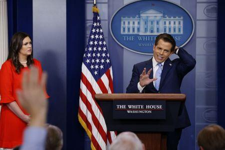 New White House Communications Director Anthony Scaramucci, flanked by White House Press Secretary Sarah Sanders, speaks at the daily briefing at the White House in Washington, U.S. July 21, 2017. REUTERS/Jonathan Ernst