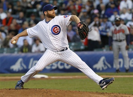 Chicago Cubs starting pitcher Ryan Dempster delivers during the first inning of a baseball game against the Atlanta Braves Tuesday, May 8, 2012, in Chicago. (AP Photo/Charles Rex Arbogast)