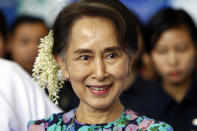 FILE - In this Dec. 14, 2018, file photo, Myanmar's deposed Leader Aung San Suu Kyi arrives to attend the Myanmar Entrepreneurship Summit at the Myanmar International Convention Center in Naypyidaw, Myanmar. The trial of Aung San Suu Kyi entered its second day Tuesday, June 15, 2021, with the prosecution presenting arguments that she incited public disorder and flouted coronavirus restrictions, part of a package of charges the ruling junta is seen as using to discredit her and consolidate its control. (AP Photo/Aung Shine Oo, File)