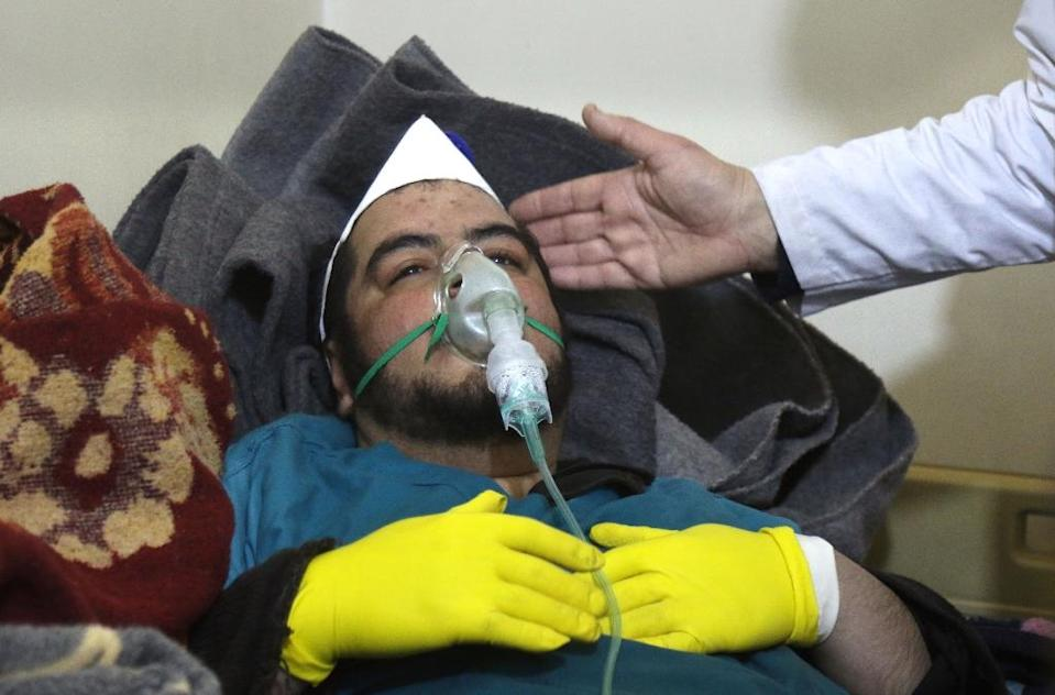 A Syrian man receives treatment at a small hospital in the town of Maaret al-Noman following a suspected toxic gas attack in Khan Sheikhun on April 4, 2017 (AFP Photo/Mohamed al-Bakour)