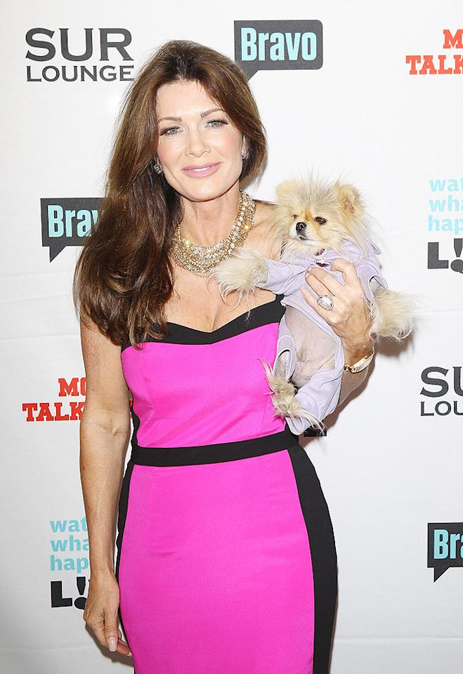 """The Real Housewives of Beverly Hills"" star Lisa Vanderpump, here with her  dog Giggy, hosted Cohen's party at her swanky restaurant, Sur, which  also has its own Bravo series in the works. (5/14/2012)"
