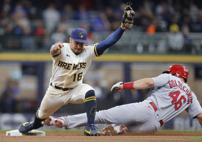 Milwaukee Brewers second baseman Kolten Wong (16) forces out St. Louis Cardinals' Paul Goldschmidt (46) at second base during the sixth inning of a baseball game Thursday, Sept. 23, 2021, in Milwaukee. (AP Photo/Jeffrey Phelps)