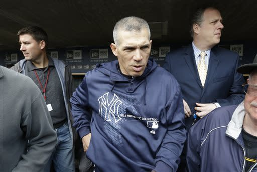 New York Yankees manager Joe Girardi walks back to the dressing room after meeting with reporters before a baseball game against the Detroit Tigers in Detroit Sunday April 7, 2013. (AP Photo/Carlos Osorio)